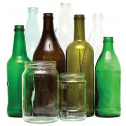 Organized recyclable glass bottles including mason jars and pop bottles.