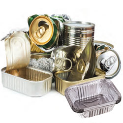 Stack of recyclable metals including tin and aluminum cans.