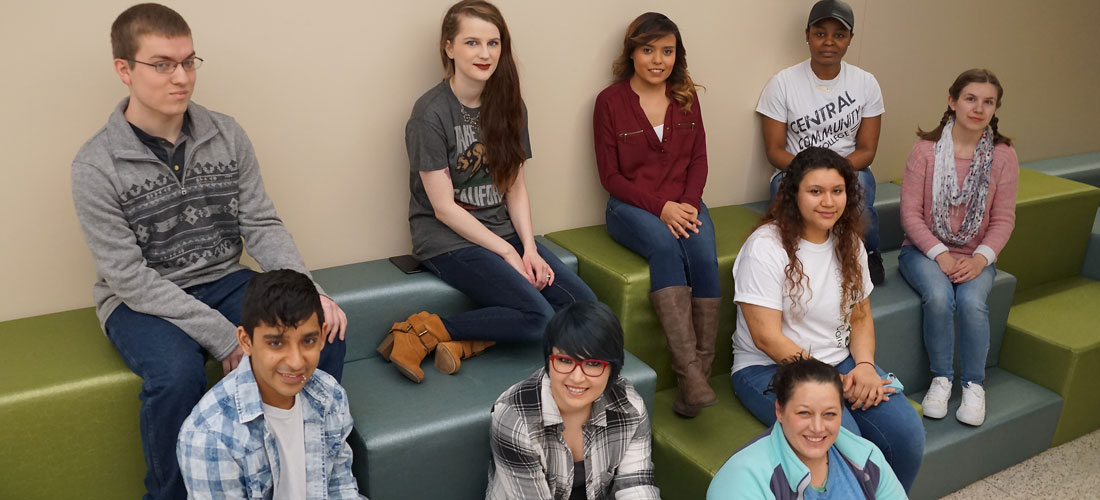 group of students sitting in the hallway
