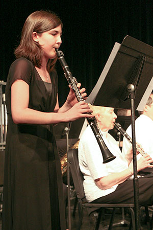 woman playing the clarinet at a concert
