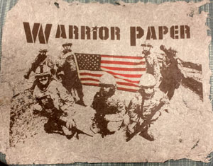 Completed warrior paper project with U.S. flag and soldiers displayed.